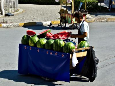 Offering slices of water melon for refreshment