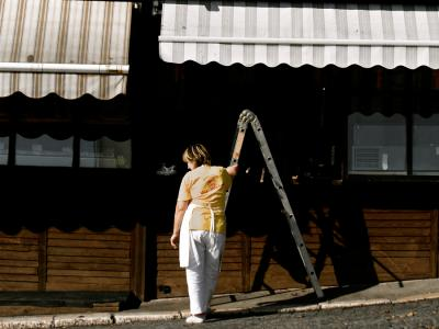 A woman cleaning her shop